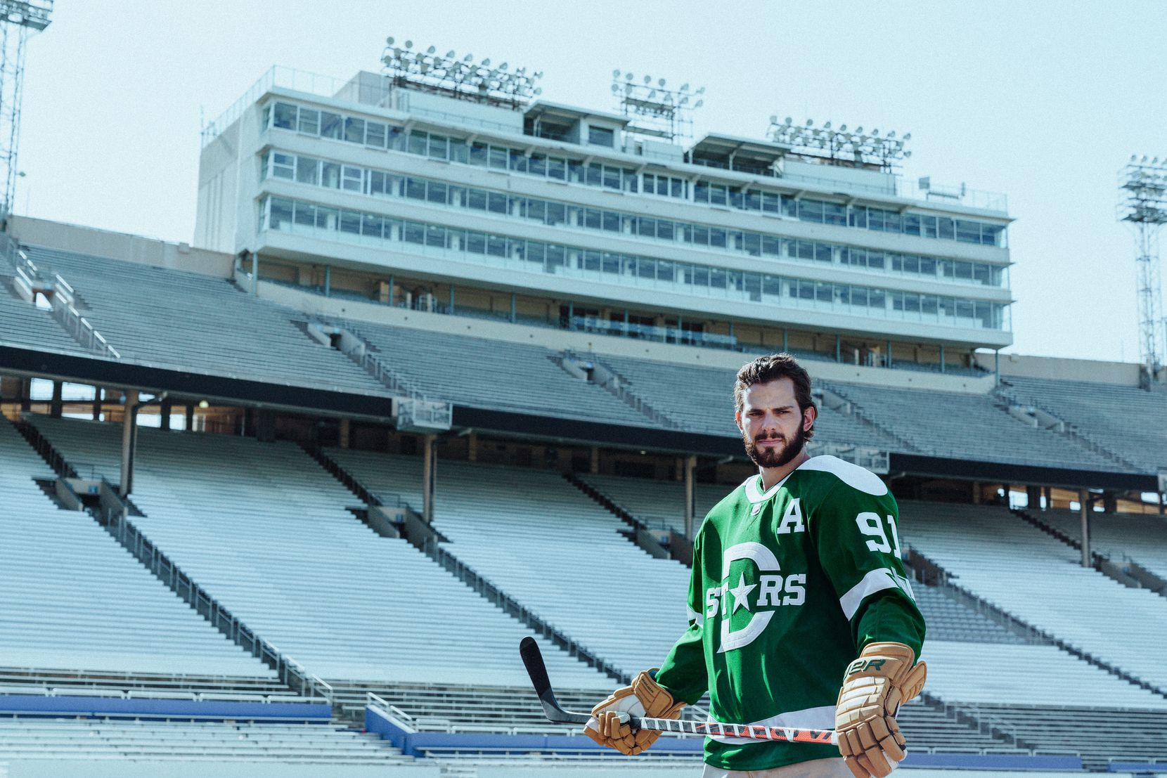 Tyler Seguin models the uniform the Dallas Stars will wear against the Nashville Predators on Jan. 1, 2020, in the Winter Classic at the Cotton Bowl.