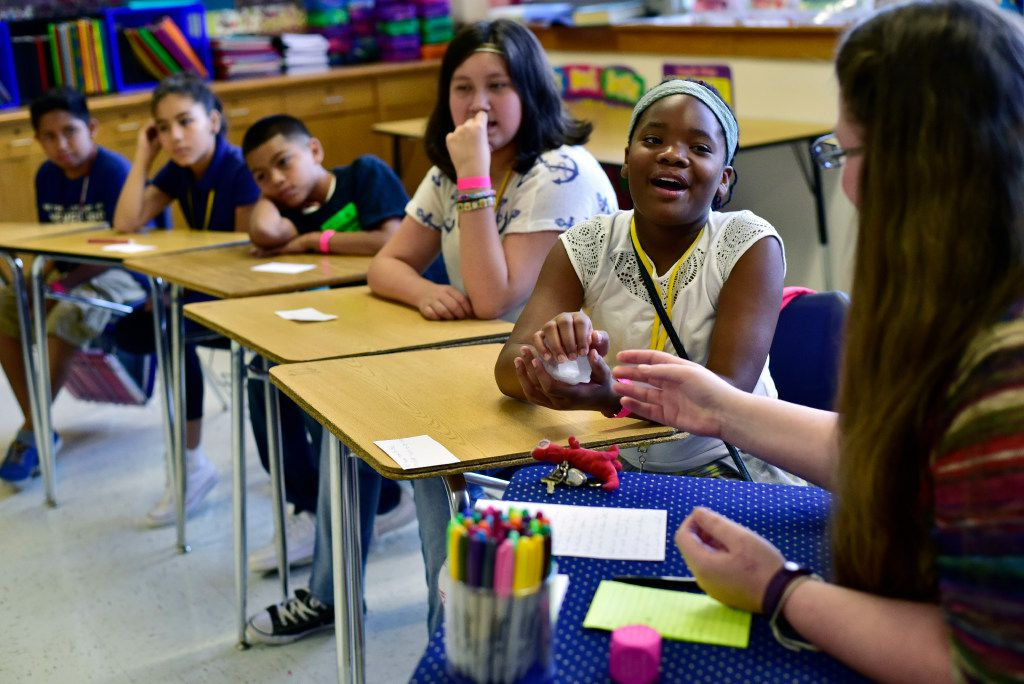 Sixth-grader Tycoriah Brown holds a talking piece while expressing her feelings to reading teacher Loretta Smith (right) during a Restorative Class session, also known to students as circling, at Gaston Middle School in Dallas. The dialogue circles are used for students to talk about their feelings and issues in and out of class. What's said in the circle, stays in the circle. (Ben Torres/Special Contributor)
