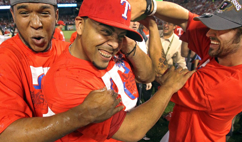 Texas'  Elvis Andrus, Nelson Cruz and CJ Wilson celebrate after Game 6 of the American League Championship Series between the Texas Rangers and the Detroit Tigers at Rangers Ballpark in Arlington, Saturday, Oct. 15, 2011. The Ranger win 15 - 5 (Louis DeLuca/Dallas Morning News) 10162011xSPORTS