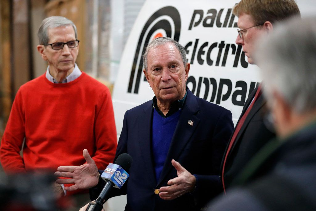 Former New York City Mayor Michael Bloomberg, speaks with media after touring the Paulson Electric Company on Dec. 4, 2018, in Cedar Rapids, Iowa.