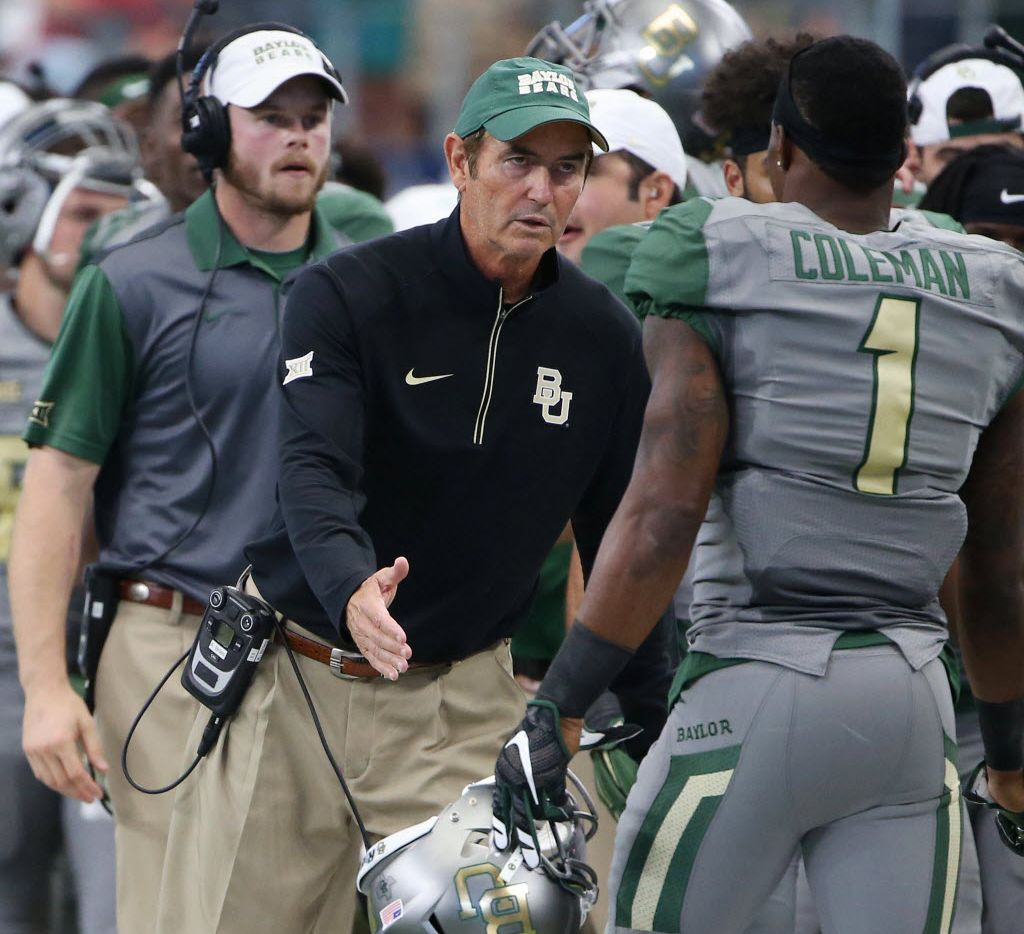 Baylor Bears head coach Art Briles congratulates wide receiver Corey Colemn in the first half during an NCAA football game between Texas Tech and Baylor at AT&T Stadium in Arlington, Texas Saturday October 3, 2015. (Andy Jacobsohn/The Dallas Morning News)