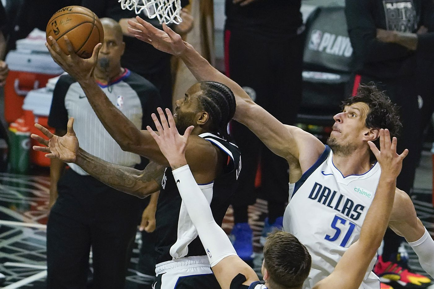 Dallas Mavericks center Boban Marjanovic (51) and guard Luka Doncic (77) defend a drive by LA Clippers forward Kawhi Leonard (2) during the first quarter an NBA playoff basketball game at the Staples Center on Wednesday, June 2, 2021, in Los Angeles.  (Smiley N. Pool/The Dallas Morning News)