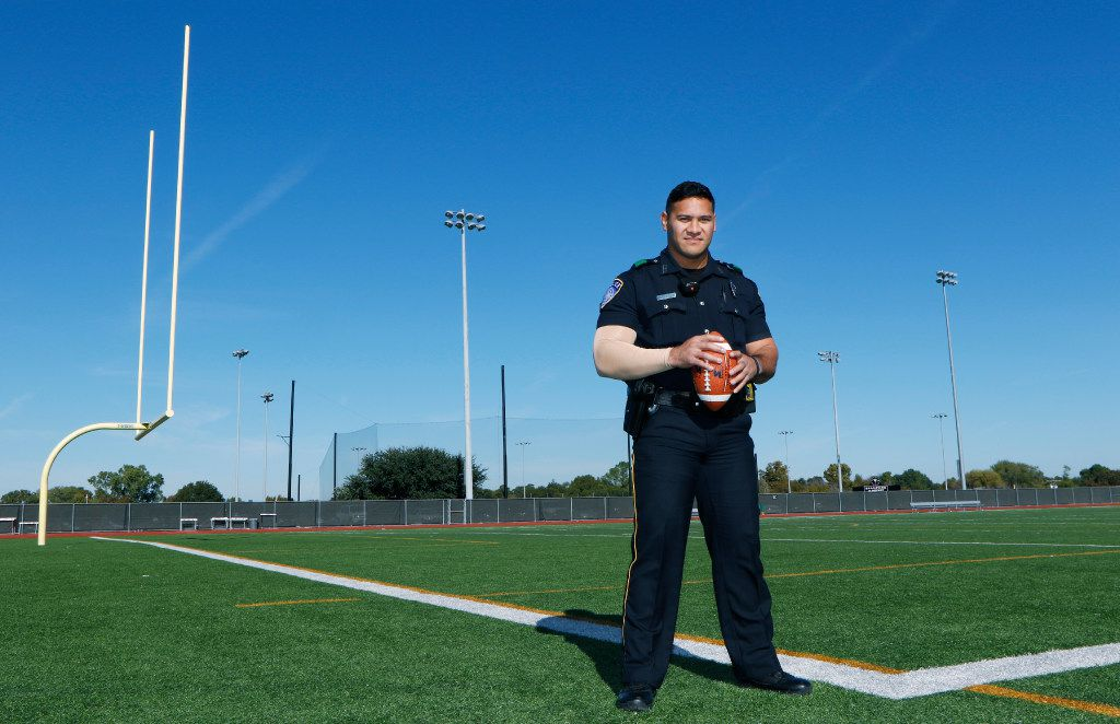 Euless police Officer Eric Fieilo stands on the practice football field at Trinity High School, where he used to be a linebacker. In a 2008 match-up with Allen High School, he made the mistake of going against the flow of a play and blindsiding an official. (David Woo/Staff Photographer)