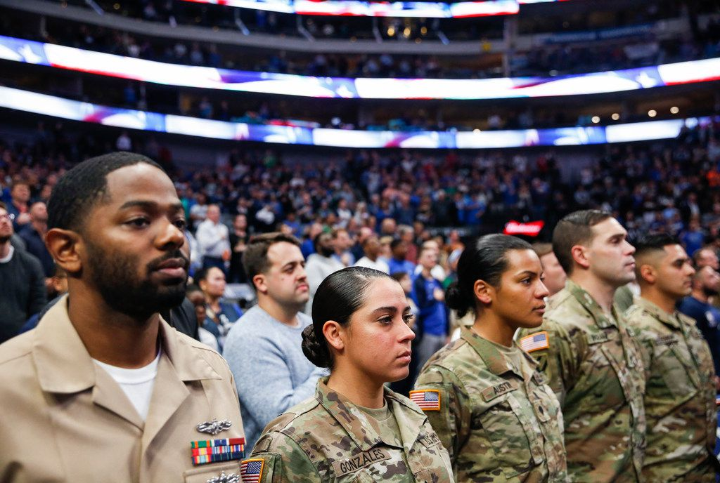 Veterans and members of the armed forces fill court-side seats for an NBA game between the Dallas Mavericks and the Orlando Magic on Wednesday, Nov. 6, 2019 at American Airlines Center in Dallas. (Ryan Michalesko/The Dallas Morning News)