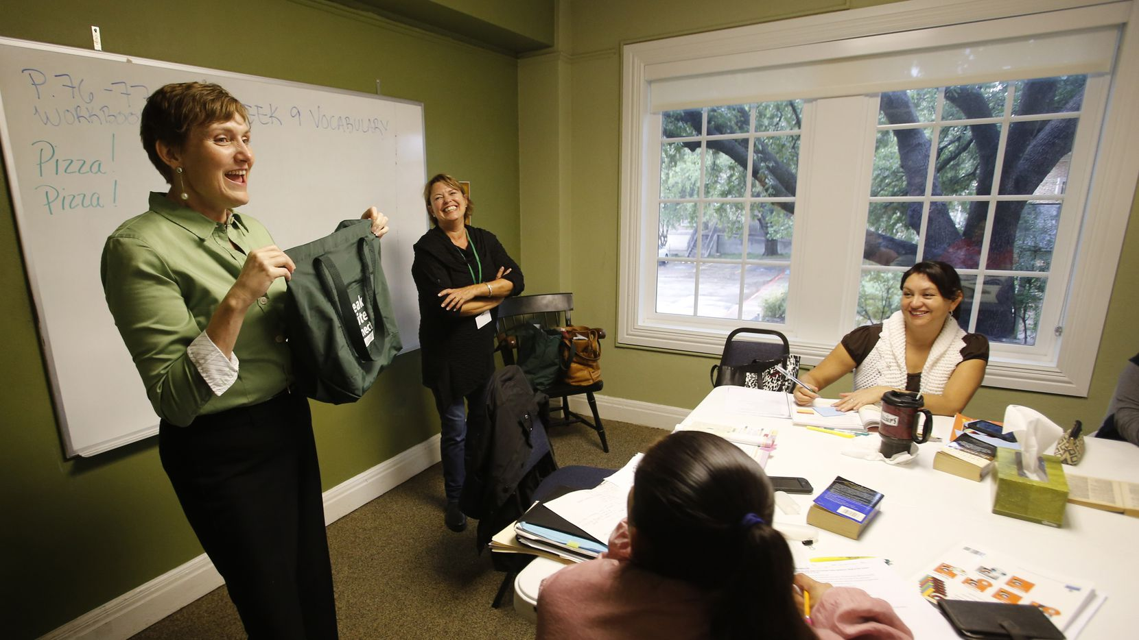 Executive Director Shana Harrison, left, of the Aberg Center for Literacy, offers some advice in an ESL class on Wednesday, November 5, 2014. Harrison will become the chief program officer of a new non-profit when the Aberg Center merges with Literacy Instruction for Texas later this year. (Louis DeLuca/The Dallas Morning News)