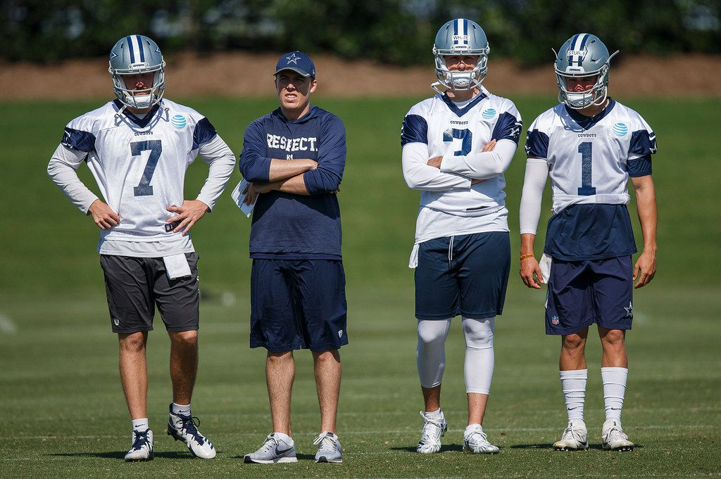 Dallas Cowboys quarterbacks coach Kellen Moore watches with quarterbacks Cooper Rush (7), Mike White (3) and Dalton Sturm (1) during the third and final round of Cowboys OTA practices at The Star on Wednesday, June 6, 2018, in Frisco. (Smiley N. Pool/The Dallas Morning News)