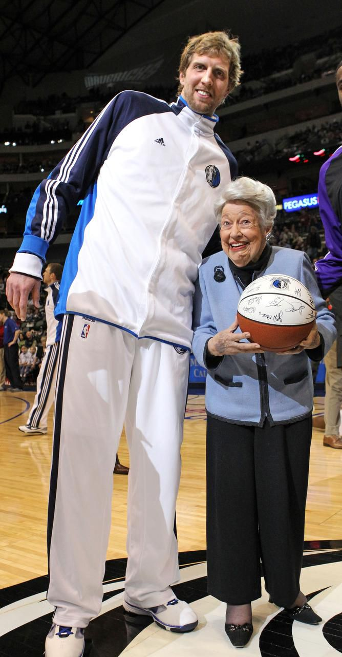 """As part of her 99th-birthday celebration, Ebby received a team-signed ball from Dirk Nowitzki before a Mavericks game. """"I tell you, I looked up and could barely see his face,"""" said the under-5-foot Ebby."""