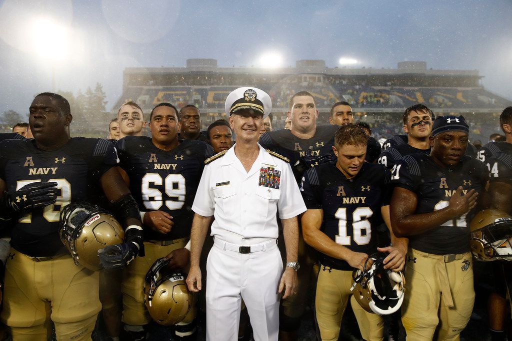 U.S. Naval Academy superintendent Ted Carter, center, stands with Navy players after an NCAA college football game between Navy and Memphis, Saturday, Sept. 8, 2018, in Annapolis, Md. (AP Photo/Patrick Semansky)
