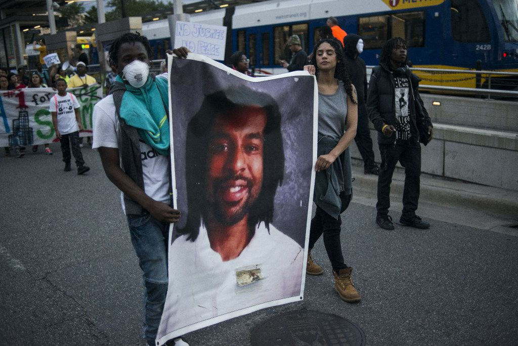 Protestors carry a portrait of Philando Castile on June 16, 2017 in St Paul, Minnesota. Protests erupted in Minnesota after Officer Jeronimo Yanez was acquitted on all counts in the shooting death of Philando Castile.