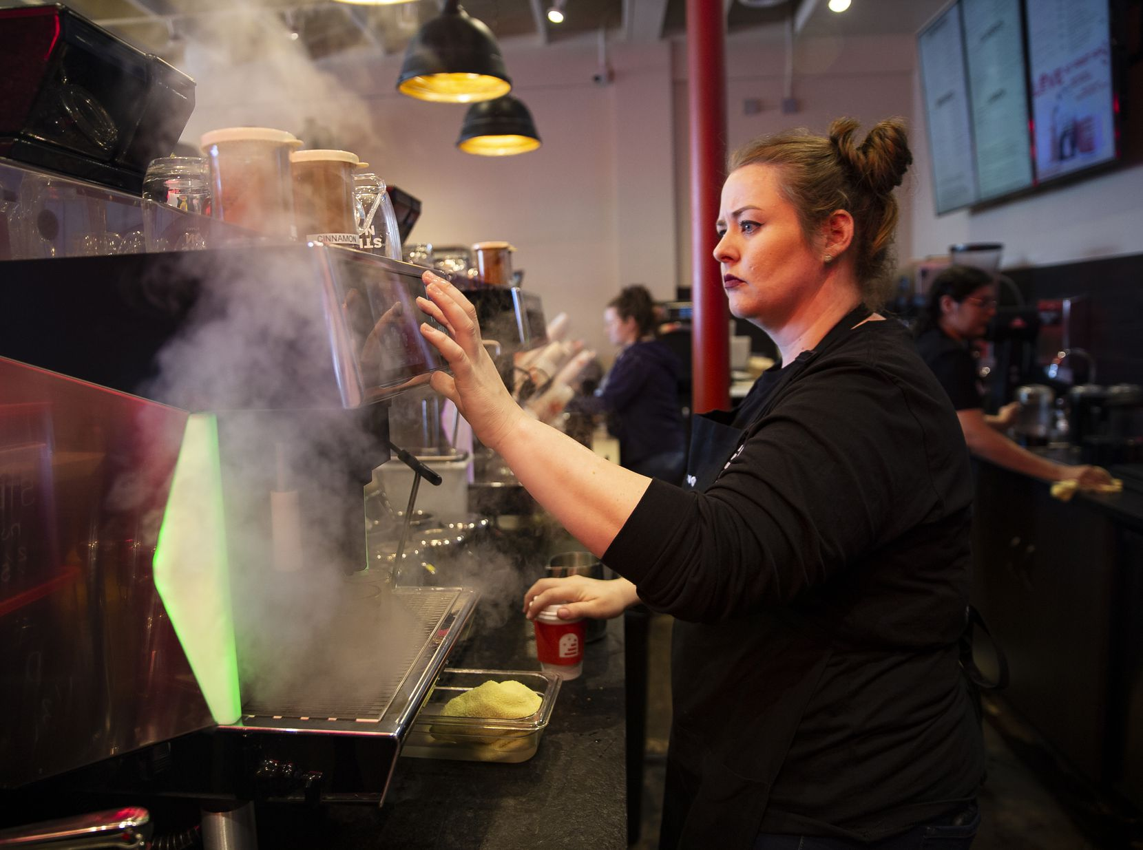 Team supervisor Meredith Owens prepares a latte at Stella Nova, a new coffee shop at Snider Plaza.