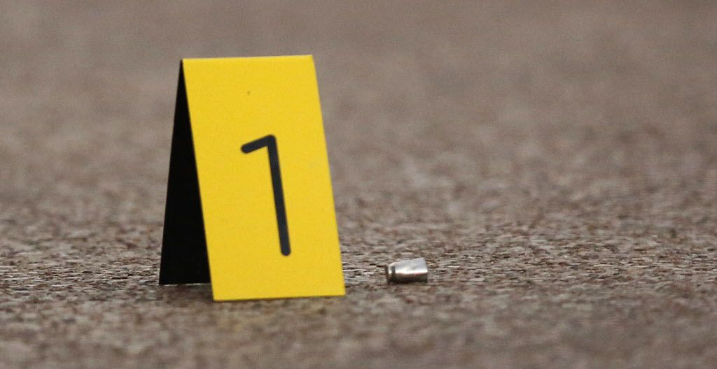 A shell casing is noted with an evidence marker in this 2016 file photo.