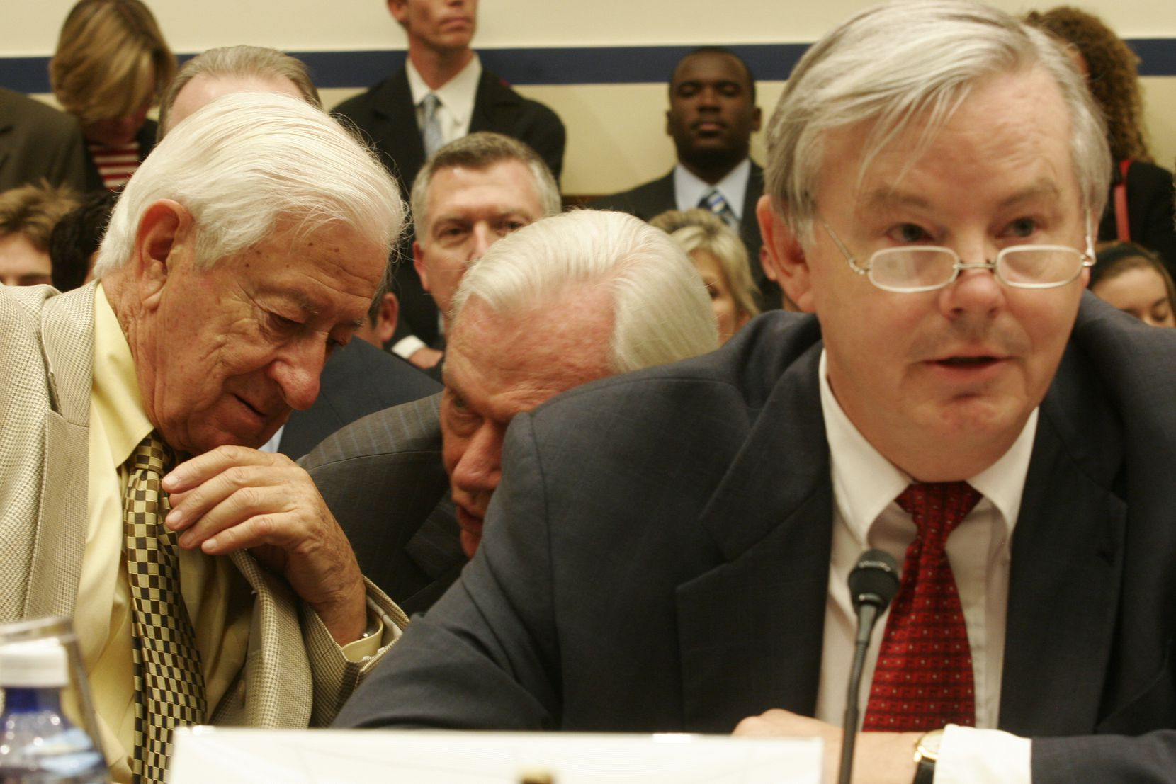 Rep. Ralph Hall (far left) had a word with Herb Kelleher, who was chairman of Southwest Airlines, as Rep. Joe Barton gave a statement during the House Committee on Transportation and Infrastructure's Subcommittee on Aviation hearing on reforming the Wright Amendment on July 12, 2006.