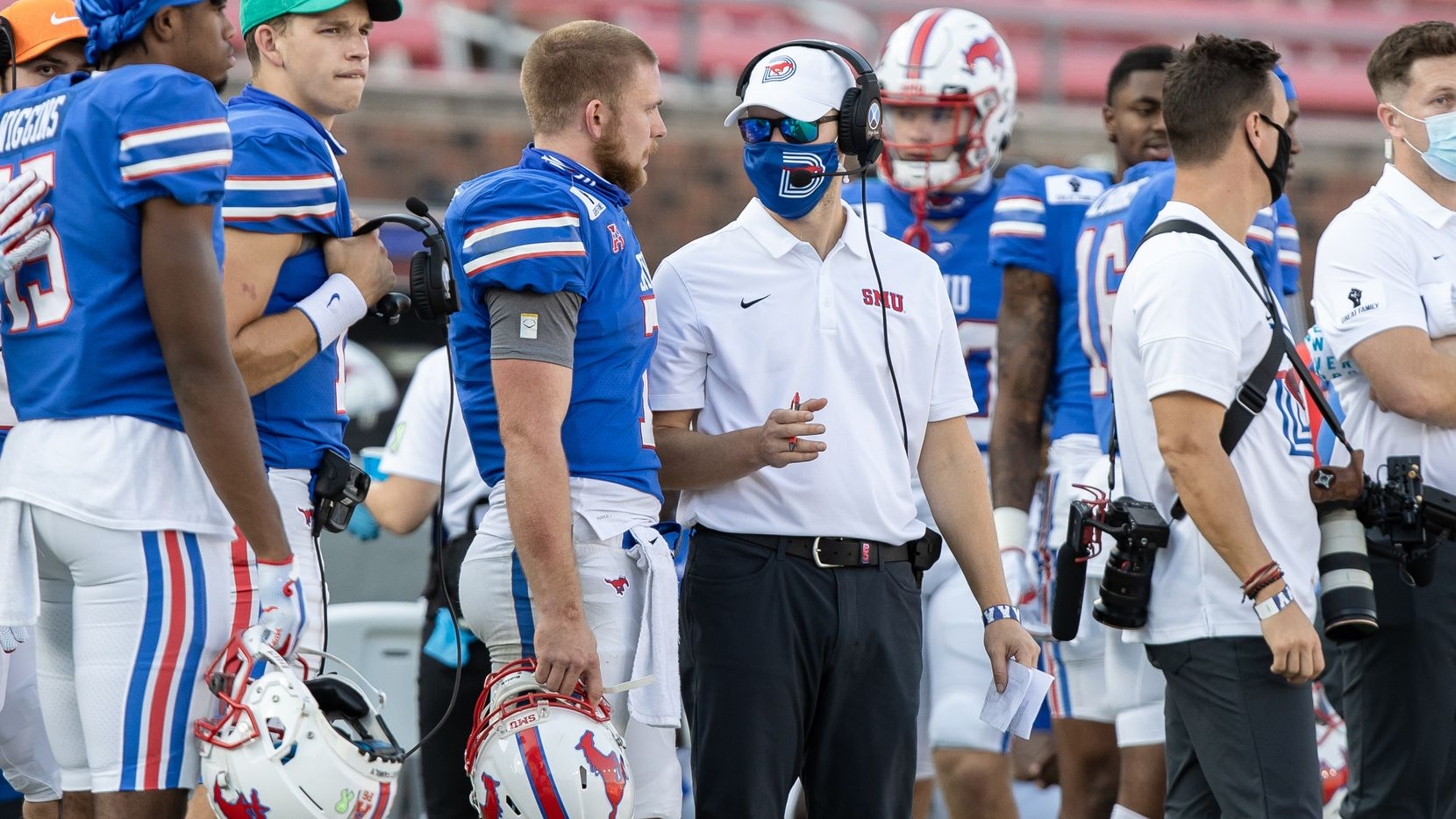 SMU offensive coordinator Garrett Riley talks to quarterback Shane Buechele (7) on the sideline during a game against Memphis on Oct. 3, 2020, at Gerald J. Ford Stadium in Dallas.