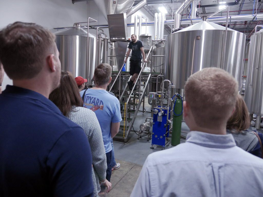 Aric Hulsey, on ladder, gives a tour of the brewery at the Community Beer Company Open House & Tour event Saturday September 13, 2014 in Dallas.