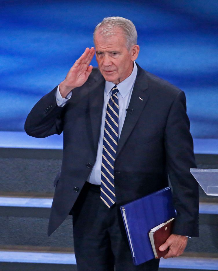 Lt. Col. Oliver North, the incoming president of the National Rifle Association, salutes to the audience after he speaks at Fellowship Church in Grapevine, Texas, Sunday, May 27, 2018. (Jae S. Lee/The Dallas Morning News)
