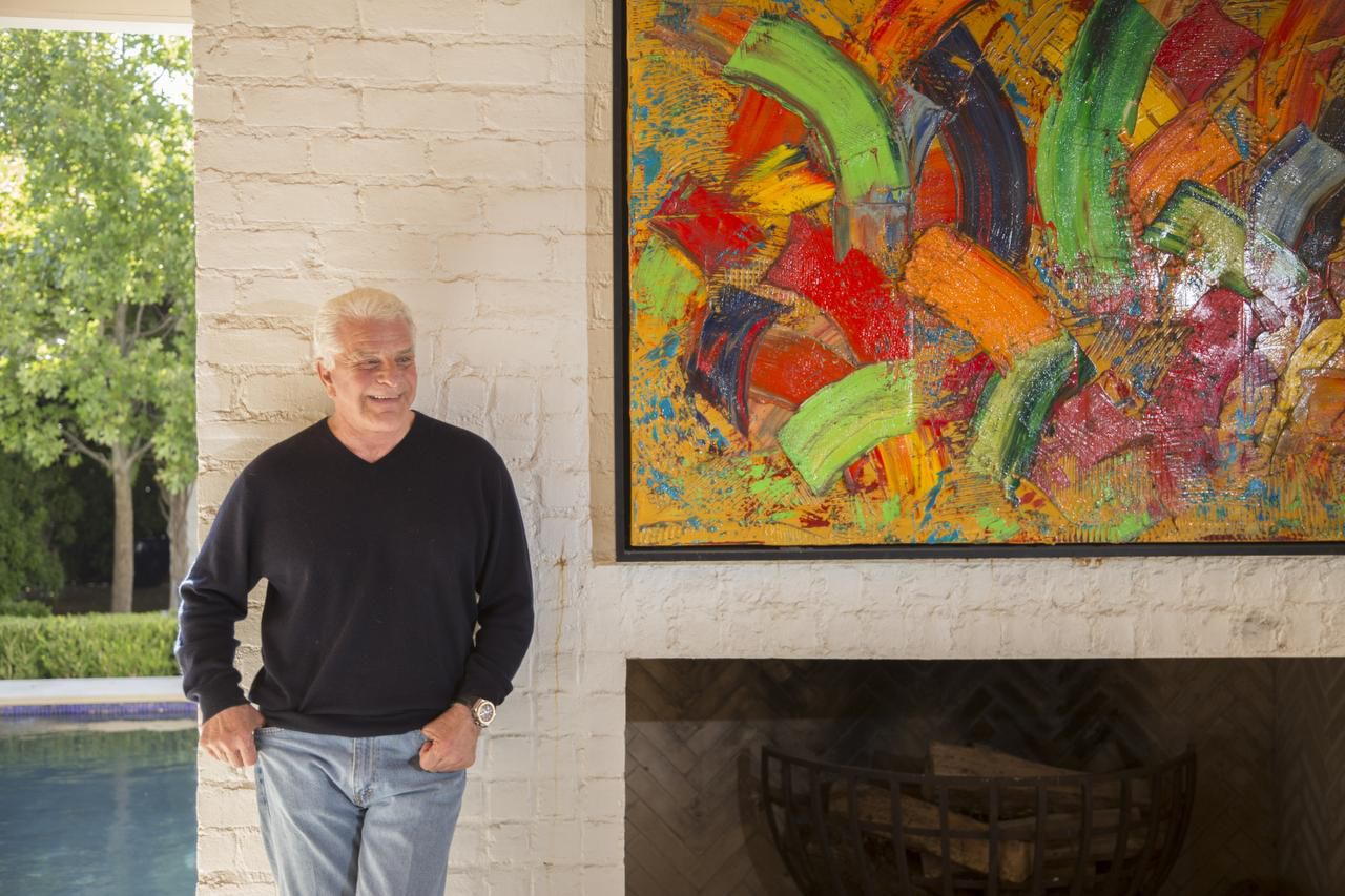 Romano's home is as much  a gallery for his contemporary art collection as it is a living space. Works of modernists hang with his own large-scale abstracts, which are typically explosions of intense, textured colors. Romano figures his paintings have fetched more than $1 million.