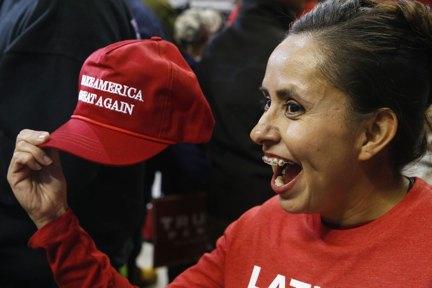 "Fans of rising conservative social media star Martha Doss take her photograph while she holds a ""Make America Great Again"" hat during a rally to reelect President Donald Trump in Bossier City, La."