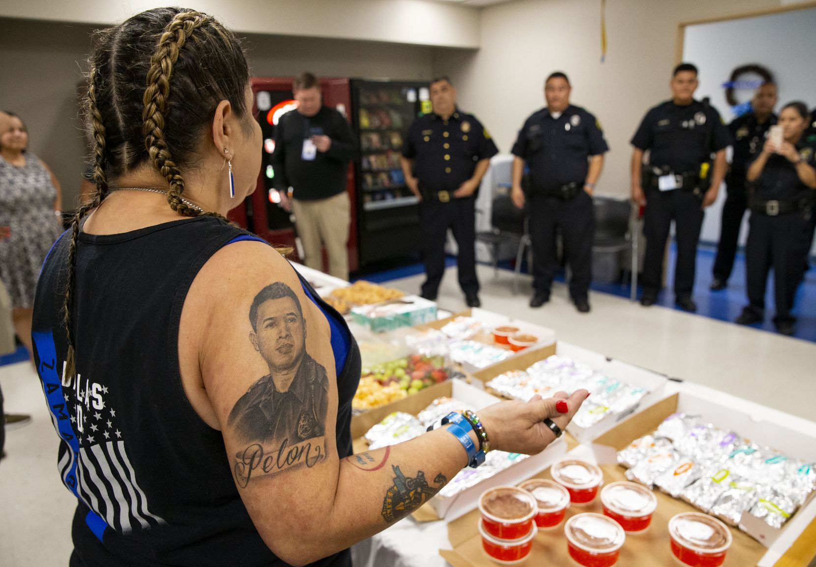 Valerie Zamarripa speaks to the Dallas police Southwest Patrol division before serving them breakfast on Friday, July 2, 2021, in Dallas. Valerie Zamarripa's son, Patrick Zamarripa, was one of the five officers who were killed when a gunman ambushed a peaceful evening of protests in downtown Dallas in 2016. (Juan Figueroa/The Dallas Morning News)