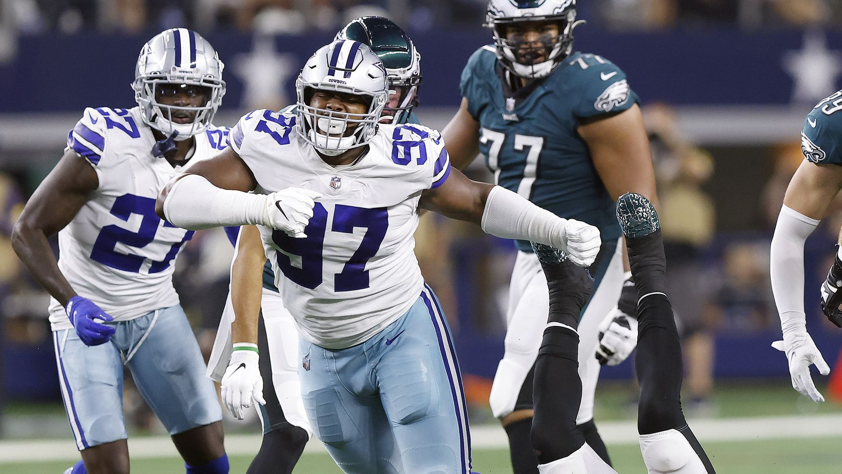 Dallas Cowboys defensive tackle Osa Odighizuwa (97) celebrates his third quarter sack of Philadelphia Eagles quarterback Jalen Hurts (1) during the second quarter at AT&T Stadium in Arlington, Monday, September 27, 2021. (Tom Fox/The Dallas Morning News)