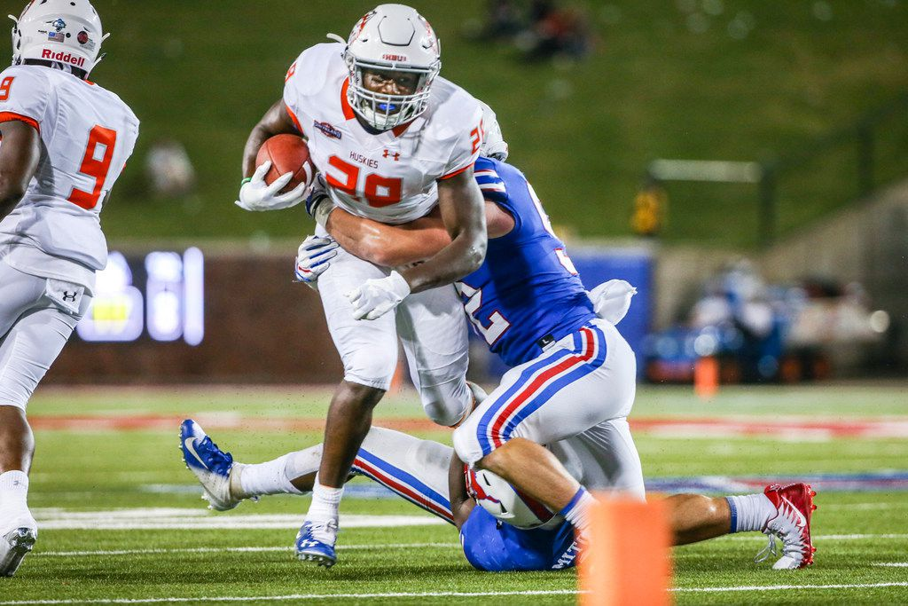 Houston Baptist running back Dreshawn Minnieweather (28) is tackled by Southern Methodist defensive end Gerrit Choate (52) during the first half on Saturday, Sept. 29, 2018, at Ford Stadium in Dallas. (Shaban Athuman/Dallas Morning News/TNS)