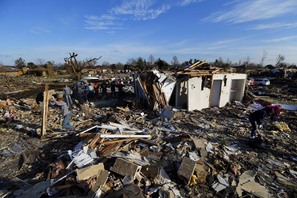 The damage on Kelso Court, south of Interstate 30 and the Bush Turnpike, after an EF-4 tornado on Dec. 26, 2015, was as extensive as any in Garland. Keith Anglin, his wife Kassie and their three teens survived the storm on the cul-de-sac and added a storm shelter when they rebuilt on the site.(Tom Fox/The Dallas Morning News)