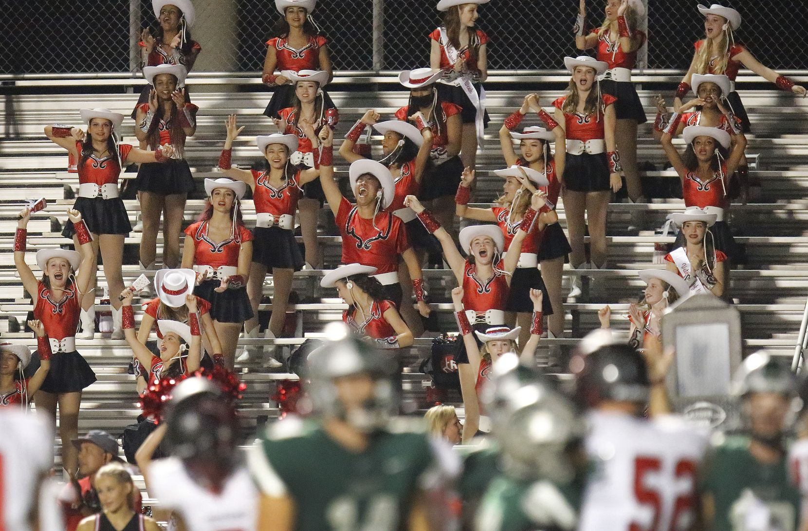 The Liberty High School Red Rythm drill team cheers as their football team tied the score with just seconds left during the second half as Reedy High School hosted Frisco Liberty High School at David Kuykendall Stadium in Frisco on Wednesday night, August 26, 2021. (Stewart F. House/Special Contributor)