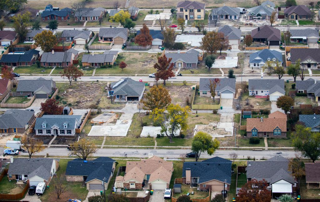 Homes near Dalrock Road as photographed from a helicopter in Rowlett, where there are about 100 still-empty lots and foundation slabs related to the Dec. 26 tornado. There are 55 such properties in Garland.