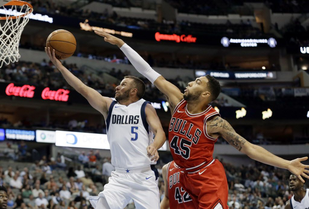 Chicago Bulls forward Bobby Portis (5) goes up for a shot after getting past Chicago Bulls guard Denzel Valentine (45) in the second half of a preseason NBA basketball game, Wednesday, Oct. 4, 2017, in Dallas. (AP Photo/Tony Gutierrez)
