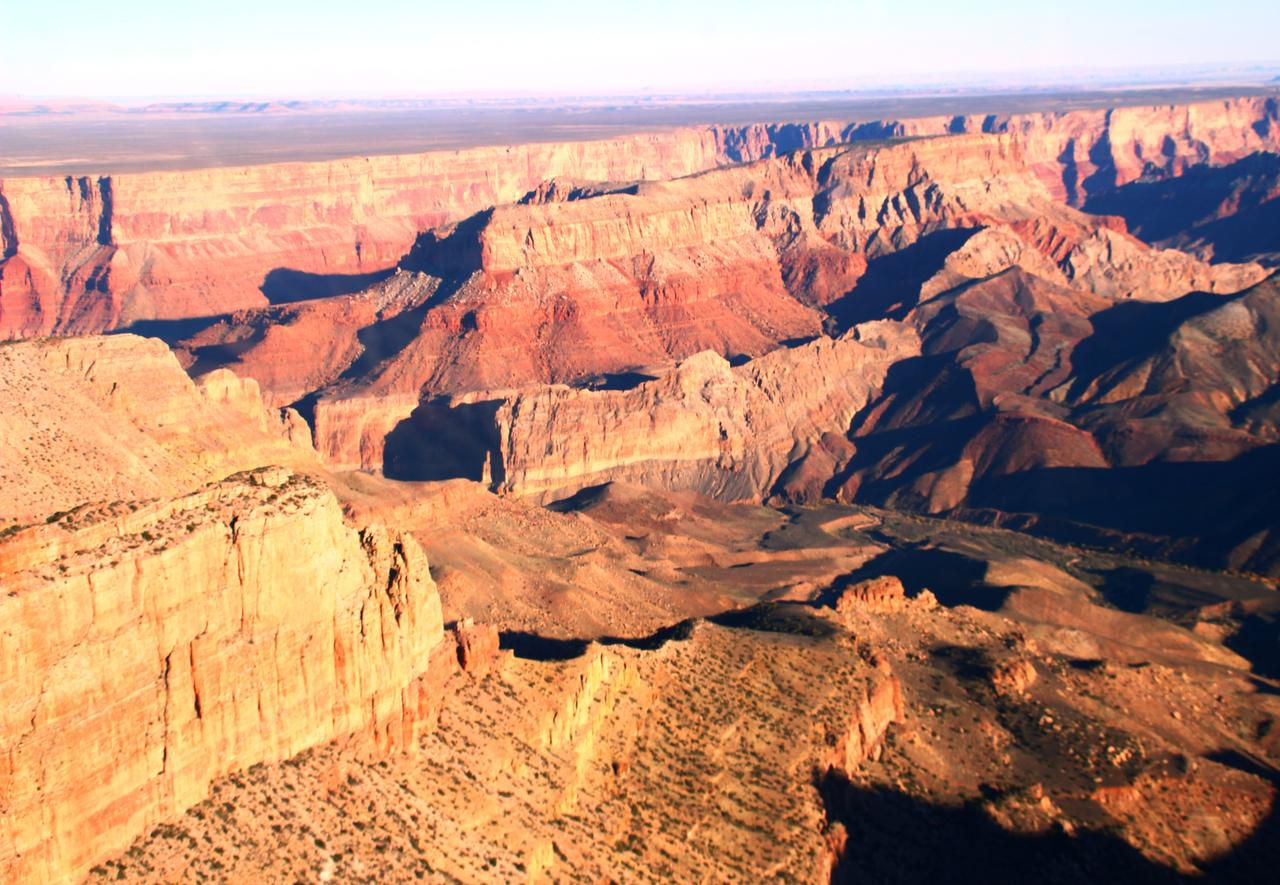 Maverick Helicopter Tours fly over the canyon and passengers get a bird's-eye view of pink, tan, white and gold rock formations.