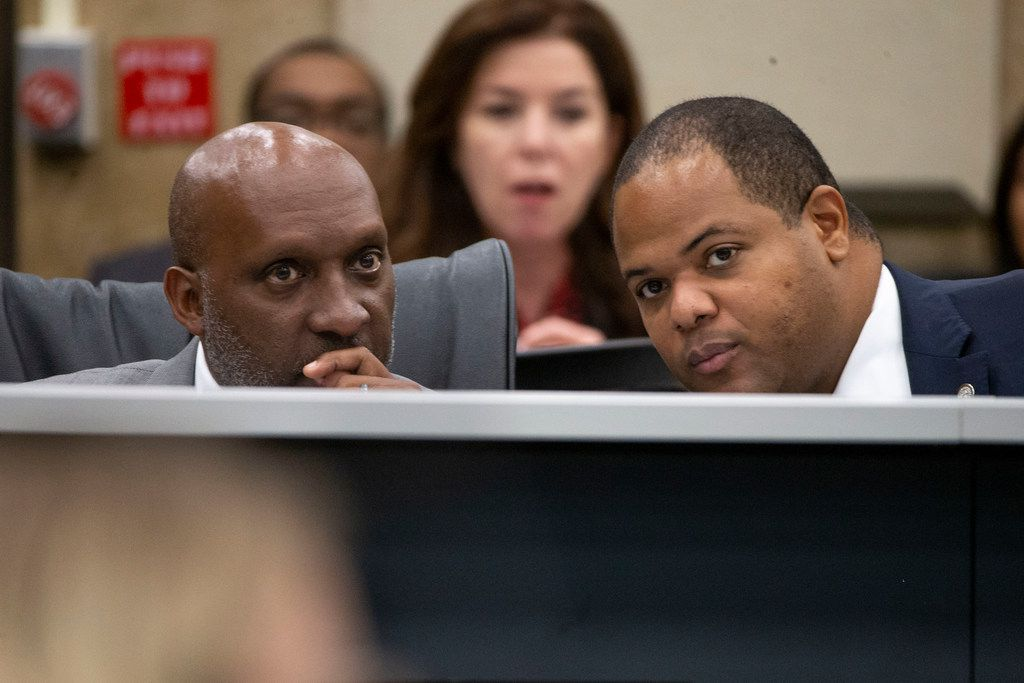 Dallas City Manager T.C. Broadnax, left, listens to Mayor Eric Johnson, right,  during a City Council briefings on Dallas Police Department staffing study on  Aug. 26. (Shaban Athuman/Staff Photographer)
