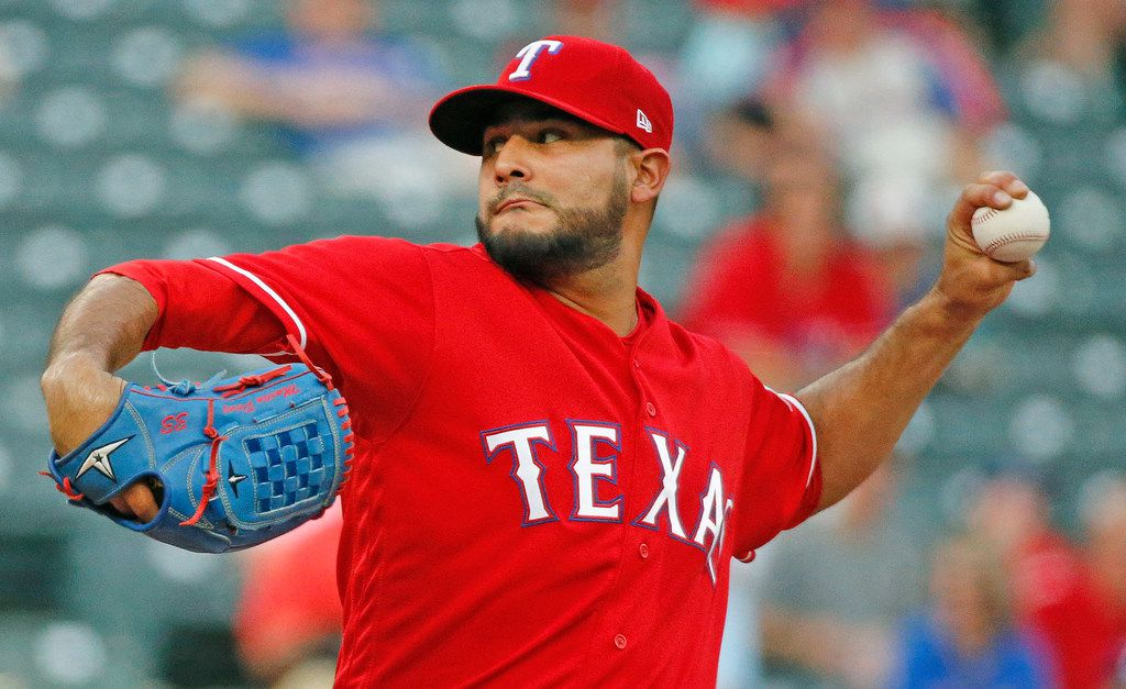 Texas Rangers starting pitcher Martin Perez (33) throws a forst-inning pitch during the Cleveland Indians vs. Texas Rangers major league baseball game at Globe Life Park in Arlington, Texas on Friday, July 20, 2018. (Louis DeLuca/The Dallas Morning News)