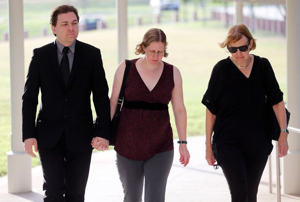 Defendant Michael Thedford walks into the Collin County Courthouse while holding hands with his wife, Jennifer Thedford on Friday. They are accompanied by her mother, Kathy Becker. Thedford is charged with criminally negligent homicide, tampering with evidence and abandoning or endangering a child after leaving his baby girl in a hot car on June 21, 2016.
