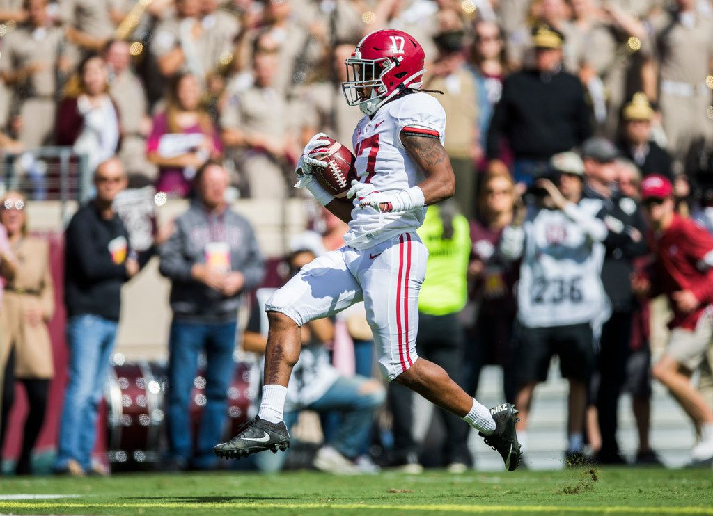 FILE - Alabama wide receiver Jaylen Waddle (17) scores a touchdown in the first quarter of a game against Texas A&M on Saturday, Oct. 12, 2019, at Kyle Field in College Station.