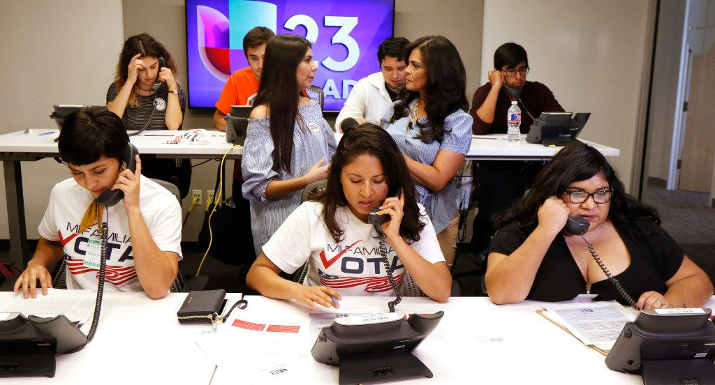 Linda Rivas, from left, Liz Magallanes, 23, center, DFW Coordinator for Mi Familia Vota, and Maria de Jesus Garza, and other volunteers answer phone calls about the DACA program at Univision TV in Dallas on Monday.