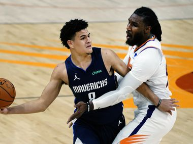 Suns forward Jae Crowder defends Mavericks guard Josh Green during the first half of a game on Wednesday, Dec. 23, 2020, in Phoenix.