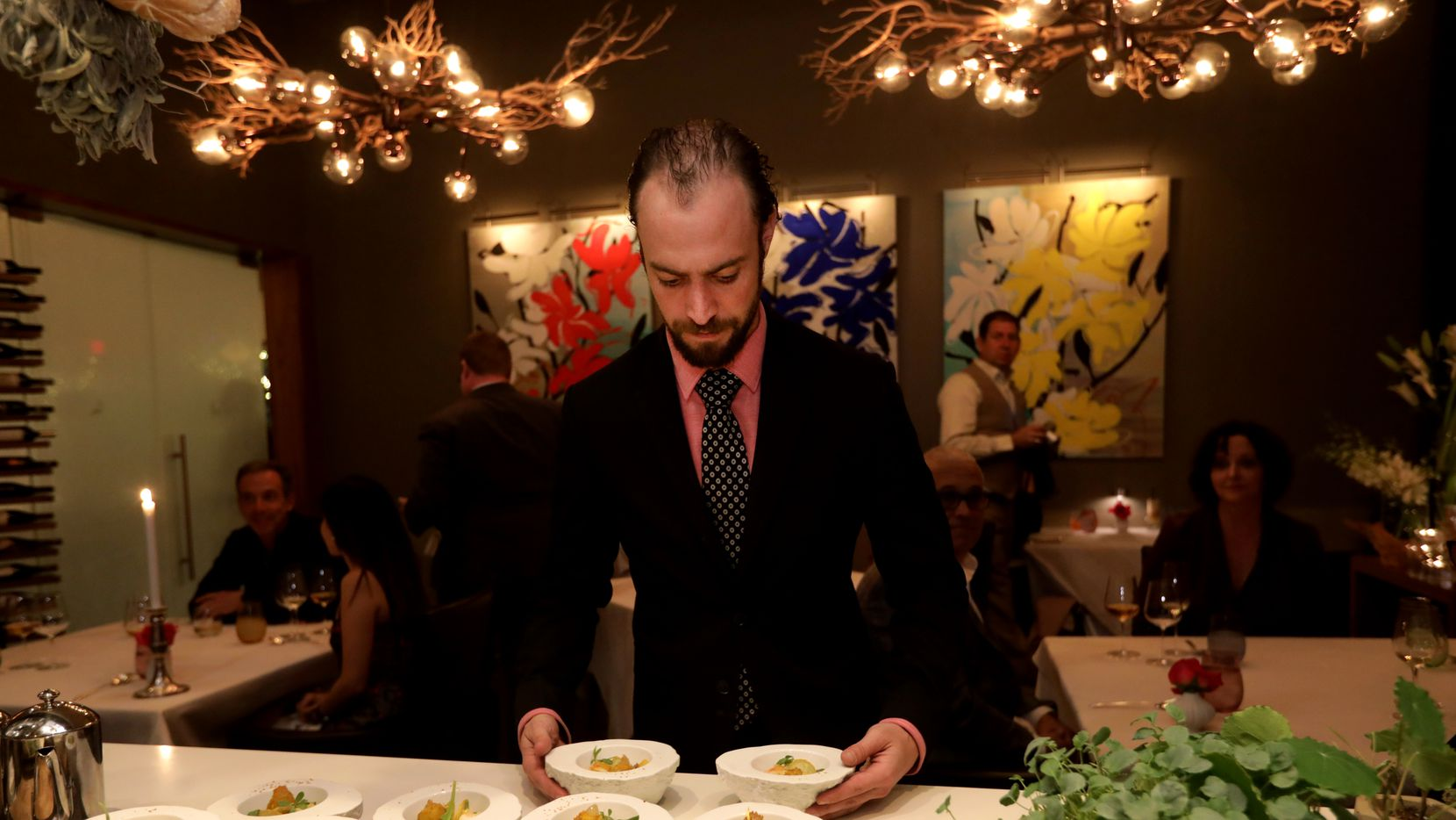 Fauna, the new restaurant-within-a-restaurant at Flora Street Cafe, serves just five tables a night. Server Tim Case delivers one of the ten courses on the the tasting menu: A king crab dish inspired by Japanses chawanmushi.
