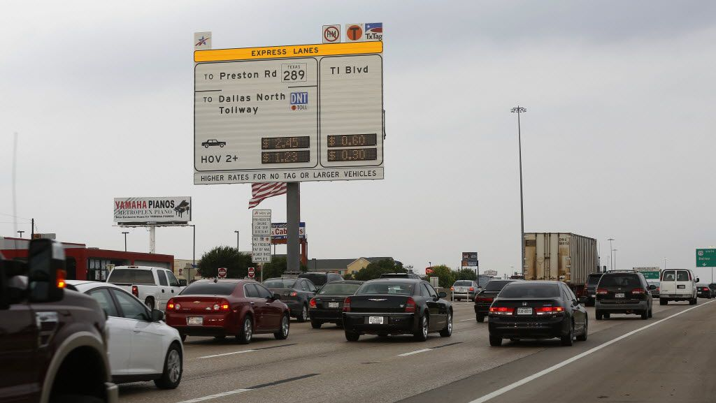 A new sign posts the cost for toll-lane users on the westbound lanes of LBJ Freeway near Greenville Avenue on the first day that toll prices were based off live traffic conditions (2014 File Photo/David Woo).