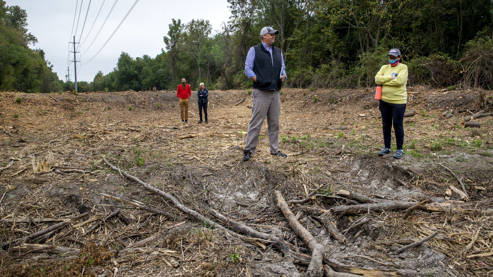 "Master naturalist Ben Sandifer and City Council member Paula Blackmon examine Oncor's clear-cutting, which Sandifer labeled as ""a local extinction event."""