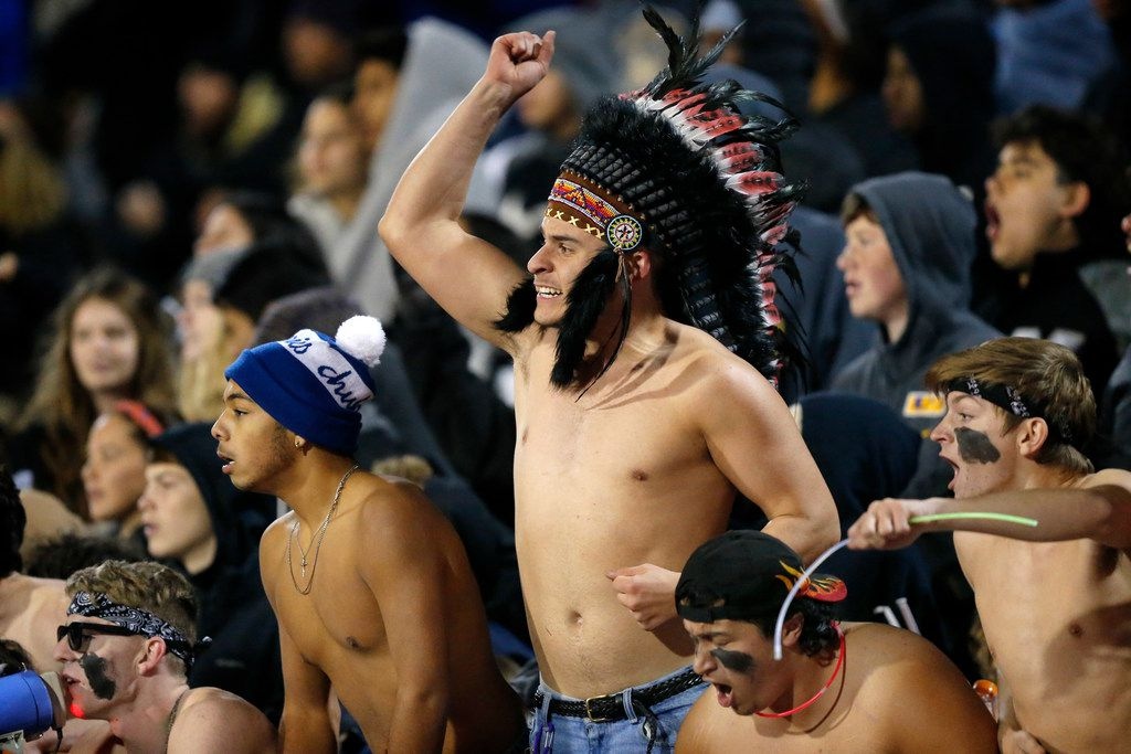 Martin students stripped off their shirts for a game against Bowie at Maverick Stadium in Arlington, Texas, Thursday, November 7, 2019. The school will no longer use the Warriors logo depicting a Native American headdress.
