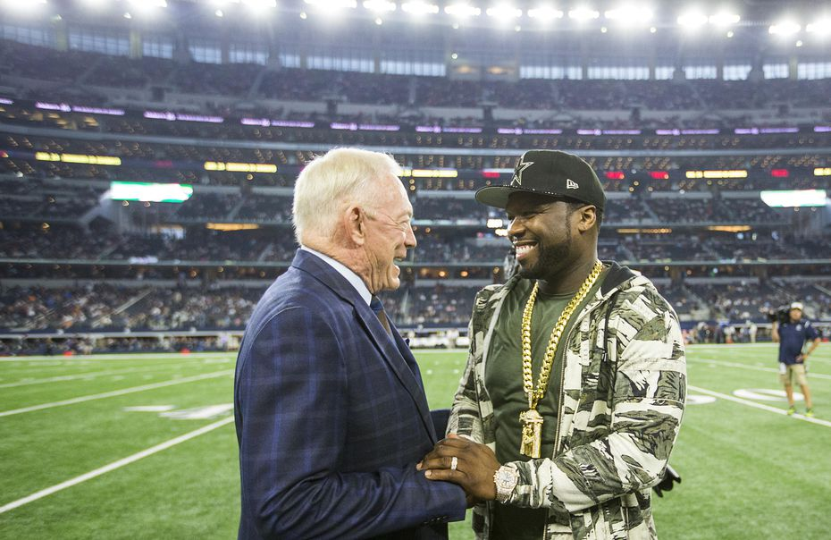 In 2016, Dallas Cowboys owner Jerry Jones chatted with 50 Cent before an NFL football game against the Chicago Bears at AT&T Stadium.