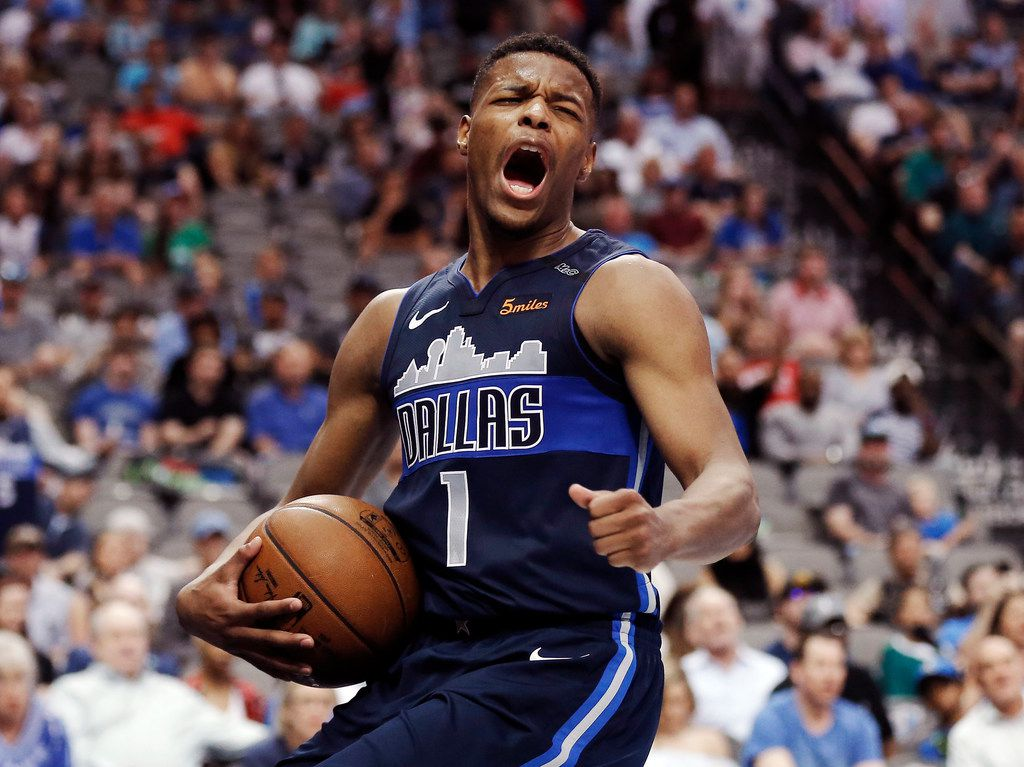 Dallas Mavericks guard Dennis Smith Jr. (1) reacts to a foul call against him during the second half of an NBA basketball game against the Charlotte Hornets Saturday, March 24, 2018, in Dallas. Charlotte won 102-98. (AP Photo/Brandon Wade)