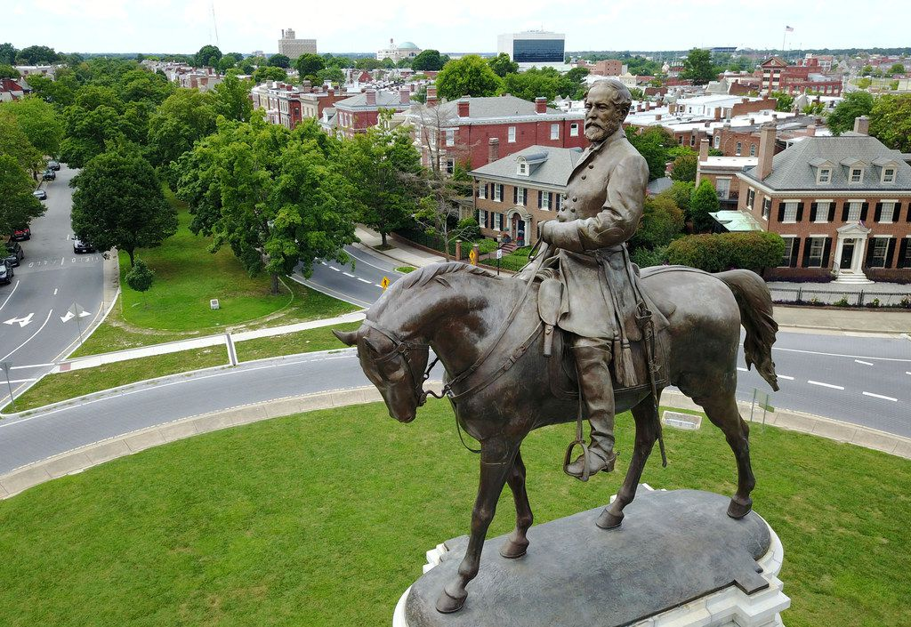 A statue of Confederate Gen. Robert E. Lee stands in the middle of a traffic circle on Monument Avenue in Richmond, Va. (File Photo/The Associated Press)