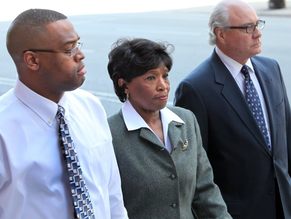 Former State Representative Terri Hodge arrives at the Earle Cabell Federal Building and Courthouse in 2010 for sentencing by U.S. District Judge Barbara Lynn.  Hodge pleaded guilty earlier this year to tax fraud for not reporting income.  On the lefrt is Hodges' son Brian Hodge an on the right, her lawyer Jeff Kearny. (FILE PHOTO)
