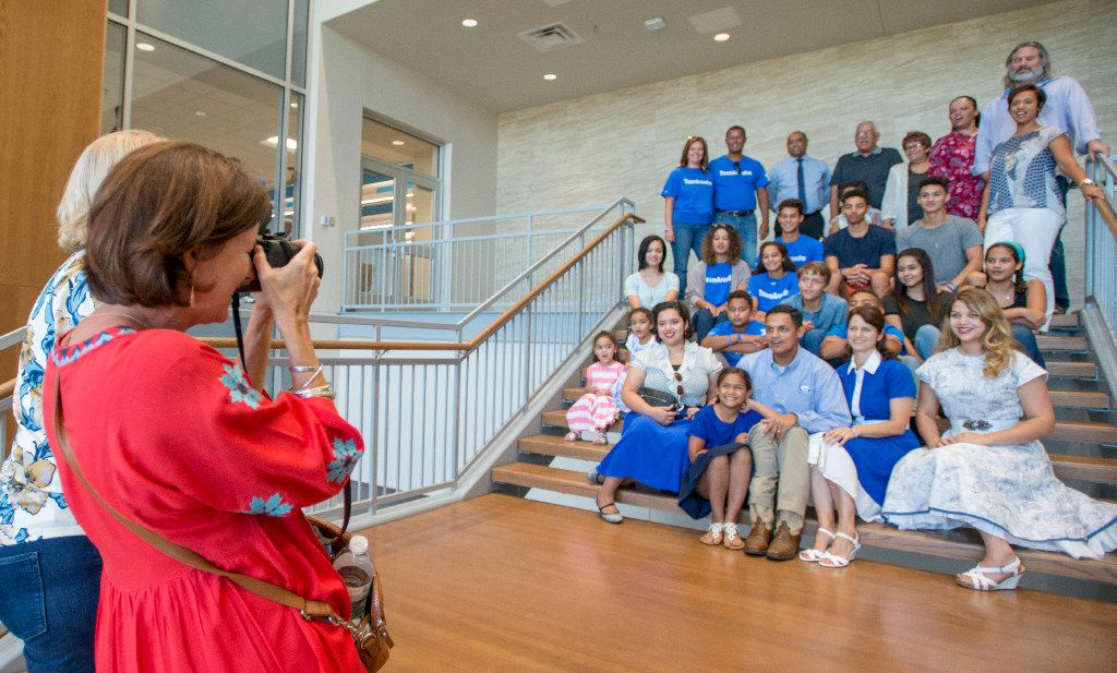 Grand Prairie High School Principal Lorimer Arendse (center) is surrounded by students, faculty, administrators, friends and family during a group photo Sunday as he toured the new learning tower on campus.