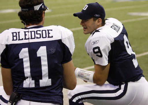 ORG XMIT: *S18F22DC9* Dallas QB Tony Romo talks with Drew Bledsoe  on the bench in the fourth quarter in NFL football action between the Dallas Cowboys and Tampa Bay Buccaneers at Texas Stadium  in Irving, Texas on Thanksgiving Day, Thursday, November 23, 2006.