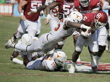 FILE - Texas linebacker Joseph Ossai (46) forces a fumble by Oklahoma running back T.J. Pledger (5) during a game in Dallas on Saturday, Oct. 10, 2020. (AP Photo/Michael Ainsworth)