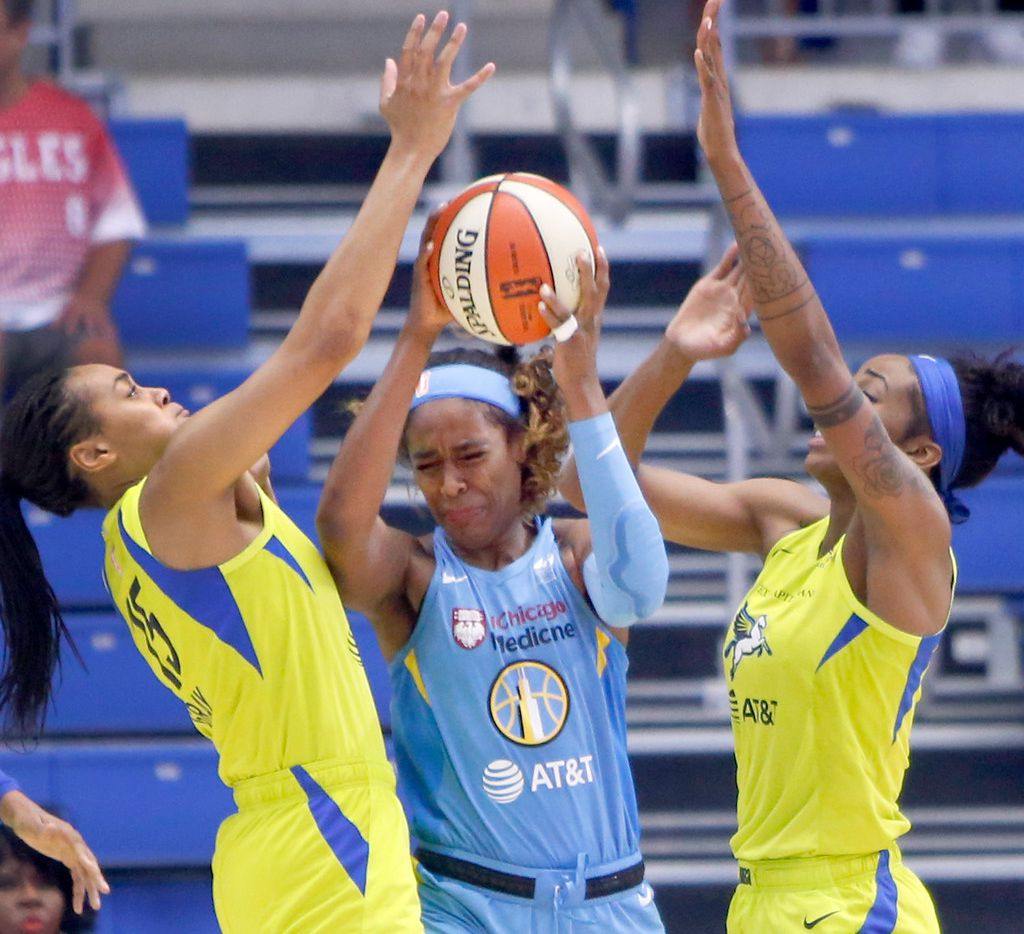 Chicago Sky forward Cheyenne Parker (32), center, feels the defensive pressure applied by Dallas Wings guard Allisha Gray (15) , left, and forward Glory Johnson (25) during first half action. Chicago defeated Dallas, 89-79. The two teams played their WNBA game at College Park Center in Arlington on July 14, 2019.  (Steve Hamm/ Special Contributor)