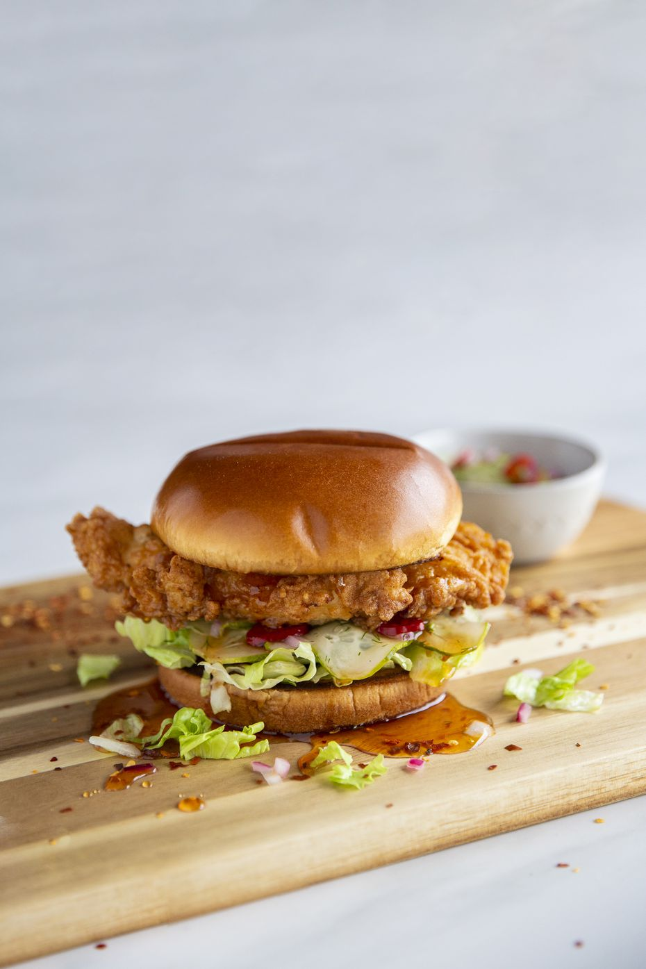 Rachael Ray's Uber Eats menu ranges from sides like sweet 'n spicy pickles to plates of pasta and sandwiches. Pictured is her fried chicken sandwich.
