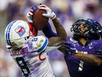 Southern Methodist Mustangs wide receiver Reggie Roberson Jr. (8) catches a pass as TCU Horned Frogs safety Trevon Moehrig (7) defends during the second quarter of a college football game between SMU and TCU on Saturday, September 21, 2019 at Amon G. Carter Stadium in Fort Worth.