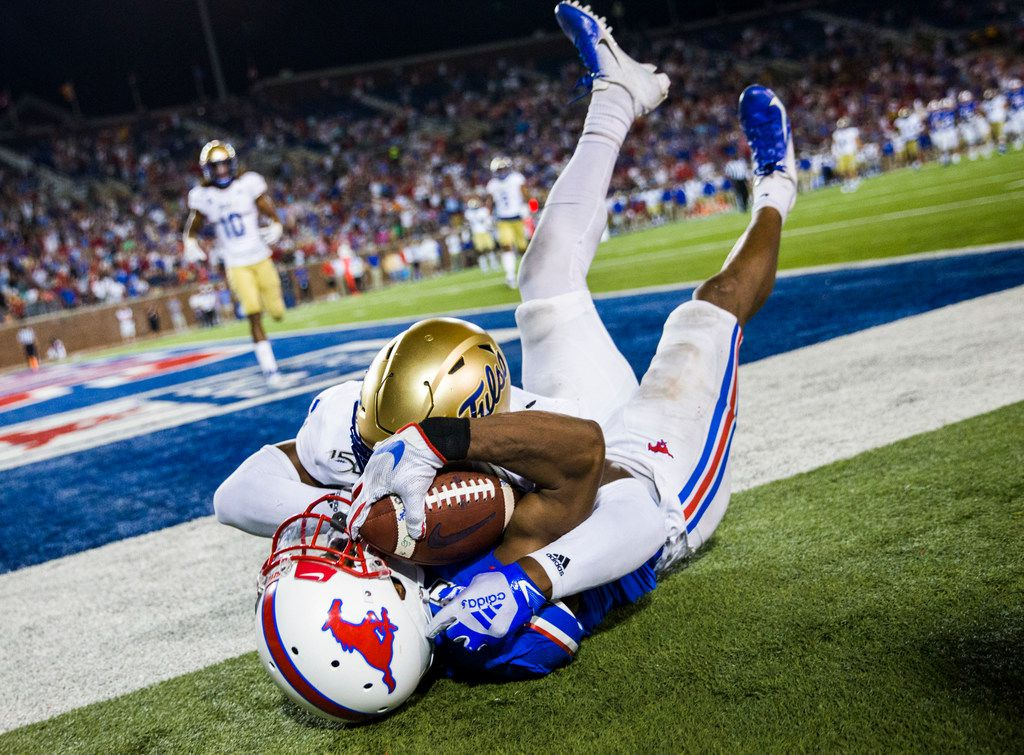 SMU Mustangs wide receiver James Proche (3) falls to the ground after catching a pass in the end zone for a 43-37 win over Tulsa Golden Hurricane in triple overtime on Saturday, October 5, 2019 at Ford Stadium on the SMU campus in Dallas. Tulsa Golden Hurricane safety Brandon Johnson (8) defended. (Ashley Landis/The Dallas Morning News)